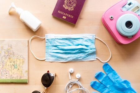 corona virus travel and tourism concept, italian passport and face mask as symbol of the traveling industry crisis and the new safety measures after the virus global outbreak