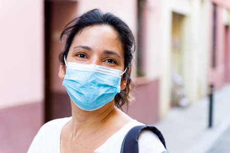 young tourist wearing face mask sightseing in european city. traveling and tourism industry during the corona virus pandemic and covid19 disease, affected by the global crisis