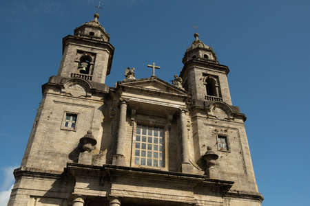 front view of San Francisco convent in Santiago de Compostela, baroque and neo classic architecture example with clear blue sky Фото со стока