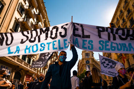 Barcelona, Spain - 16 october 2020: hospitality sector worker affected by covid protest and demonstrate against the bar and restaurants closure imposed by the generalitat, the catalan government, to stop the spread of corona virus Editorial