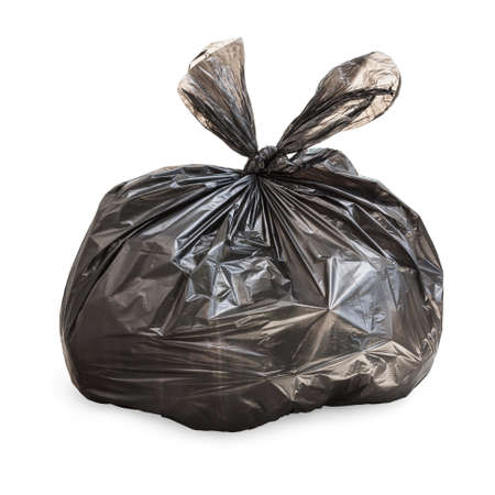 Black tied garbage bag on white Standard-Bild