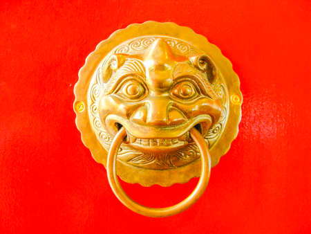 red door: Chinese door knob on red door background