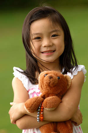 Asian Girl With Her Brown Bear Imagens