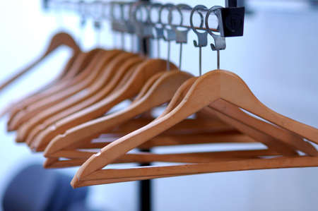clothes rack: empty clothes hangers lined up