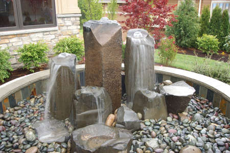 water fountain in front of a mansion
