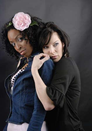 black lesbian: Two models pose as a lesbian couple