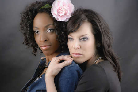 Two models pose as a lesbian couple