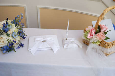 Wedding reception sign in book on a white linen covered table