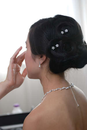 diamond necklace: Bride is getting ready before the wedding cerimony