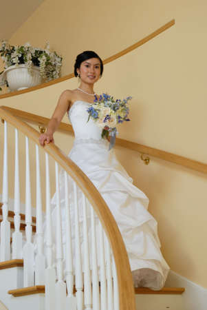 upstairs: Young Asian Bride coming down from upstairs