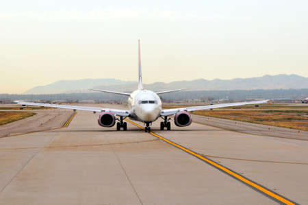 an airplane waiting on the runway