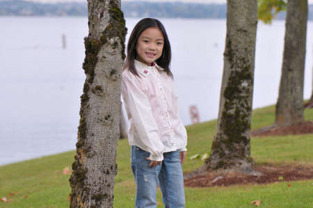 Little Chinese girl posed for a photo shoot Imagens