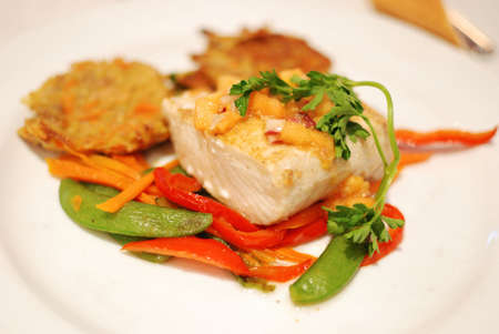 baked cod with vegetables on a plate