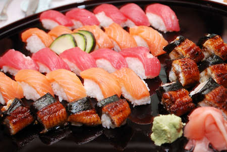 rolls of various sushi on a plate Stock Photo