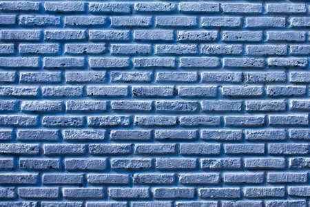 Arri�re-plan de mur de brique carr� bleu