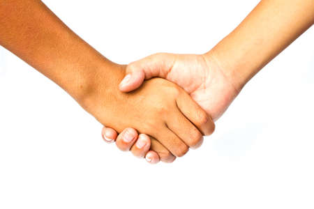 Shaking hands of two male people photo
