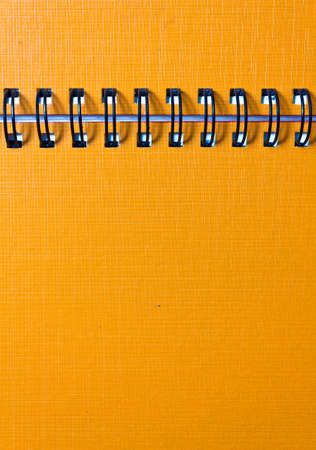 The cover of the orange notebook, closeup Stock Photo - 9993014