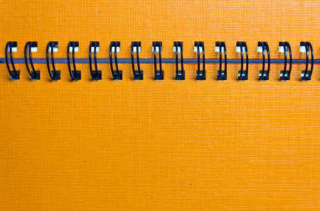 The cover of the orange notebook, closeup Stock Photo - 9993015