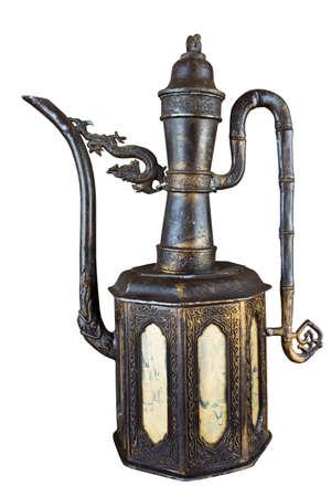 The old iron tea pot isolated on white background