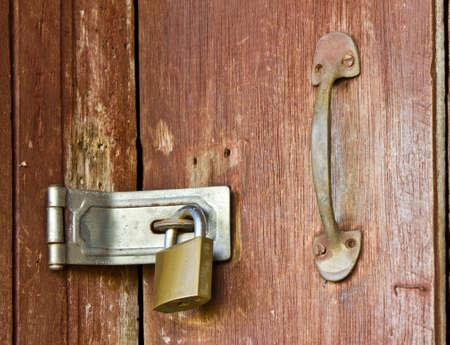 the old locked on wooden door