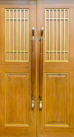 The wooden front door of a home Stock Photo