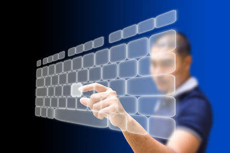 Asian businessman pushing keyboard on the touchscreen Stock Photo