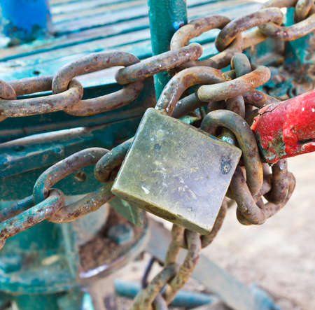 the old lock and the old iron chain Stock Photo - 11438689