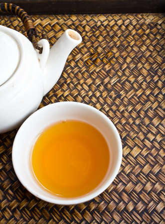 a cup of tea and the tea pot Stock Photo