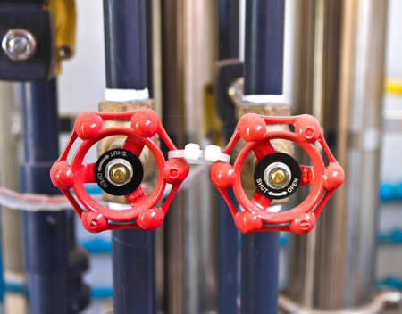 stop gate valve: double red valves to control flow through pipework.