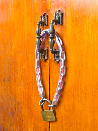wooden doors are locked with a key Stock Photo - 13267594