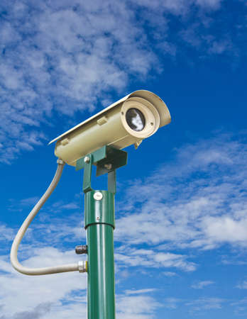 Security camera and blue sky