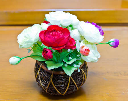 decorative flowers on the wooden table photo