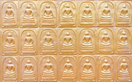 the row of buddha on the public temple wall in Thailand Stock Photo - 14911539