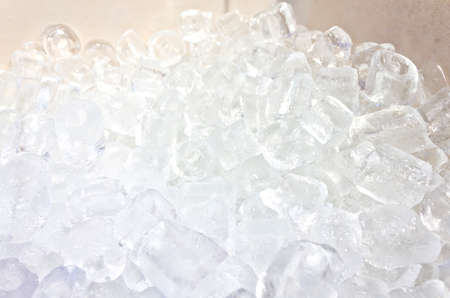 close up of many ice cubes in the box
