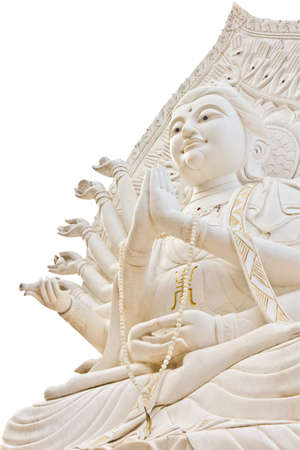 Guan Yin statue on white background with clipping path photo