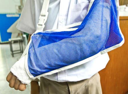 Thai boy students arm is broken Stock Photo