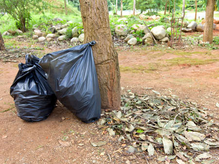 Black garbage bags for cleanup in the park Stock Photo