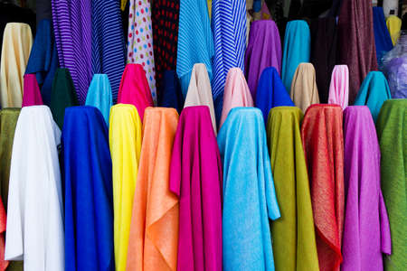 colorful from the row of fabrics in fabric store
