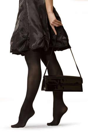 gait: silhouette of womanish feet Stock Photo