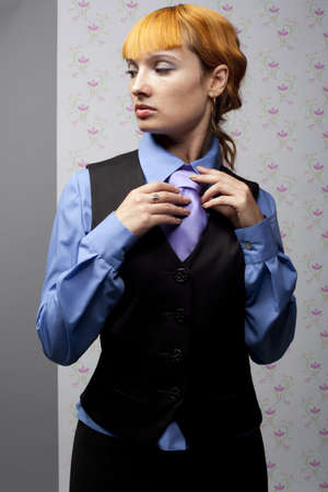 young girl straightens his tie