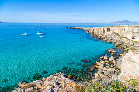 Lagoon with vessels on Favignana island in Sicily, Italy
