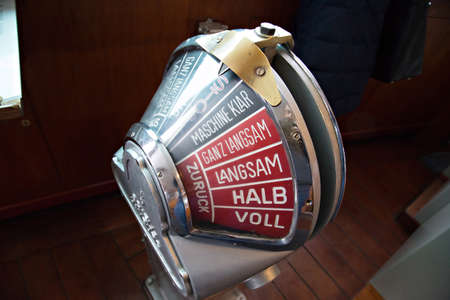 astern: Old engine order telegraph on stand-by mode in Port of Hamburg, Germany Stock Photo