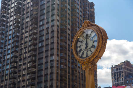 broadway tower: Sidewalk clock at 200 Fifth Avenue 1909 with Flatiron building facade on June, 28th 2012 in NY. Completed in 1902. Stock Photo