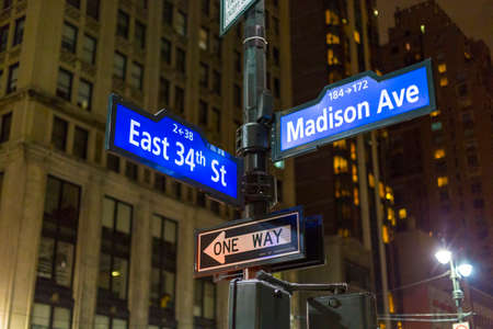 ave: NYC signpost in Midtown Manhattan at landmark streets Madison Ave and 34th St