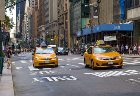 taxicabs: Traffic in New York City with famous yellow-coloured taxi cabs passing by