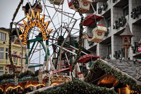 a nocturne: Carousel rotating at Christmas market fair in Cologne, Germany