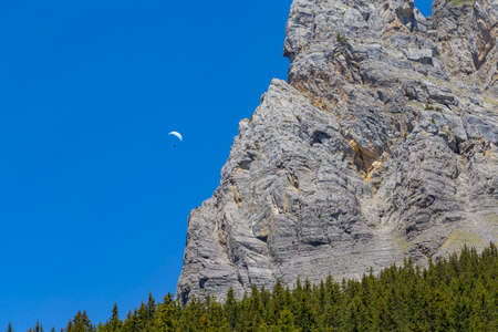 the bernese oberland: Paraglider against Swiss Alps and clear blue sky near Oeschinensee Oeschinen lake, on Bernese Oberland, Switzerland