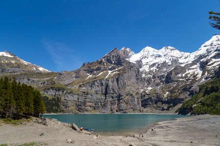 oberland: View of Oeschinensee Oeschinen lake with Bluemlisalp and Frundenhorn of Swiss alps on Bernese Oberland Stock Photo
