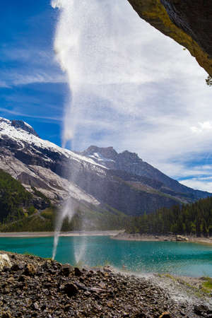 bernese oberland: Swiss Alps waterfall near Oeschinensee Lake in Bernese Oberland, Switzerland
