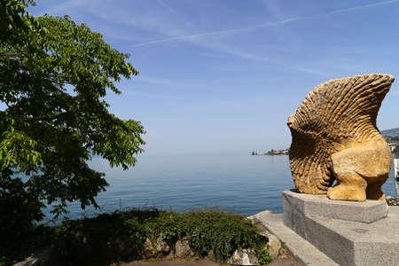 gaspard: Homme Poisson Volant sculpture by Gaspard Delachaux at Quai de la Rouvenaz, on the banks of Lake Geneva, Swiss Riviera, Montreux, Switzerland